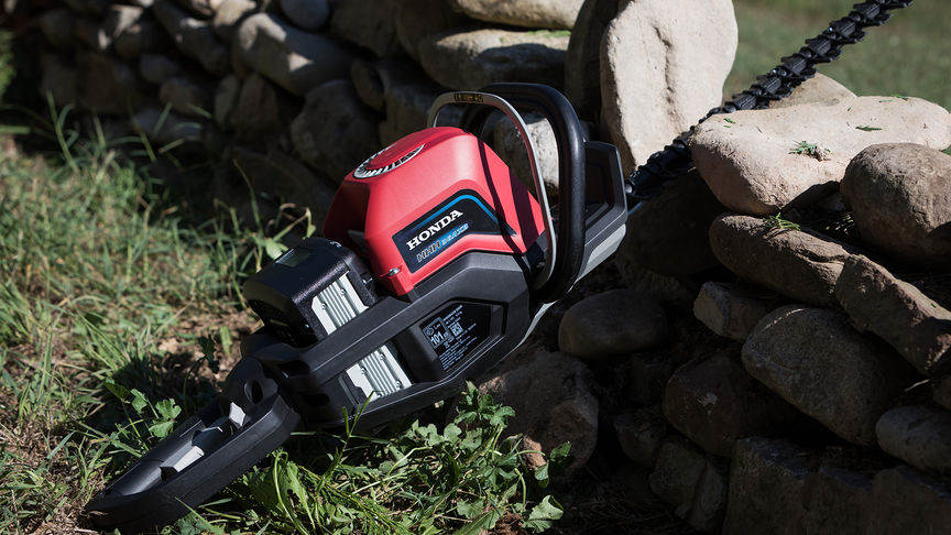 Close up of Honda's cordless hedge trimmer in garden location.